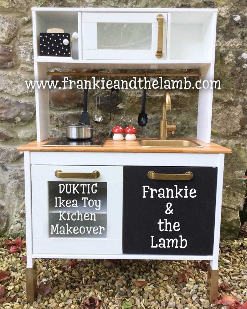 Frankie & the Lamb customises the DUKTIG Ikea toy kitchen for Luther's playroom. Gold trimmings and chalkboard door to draw on.